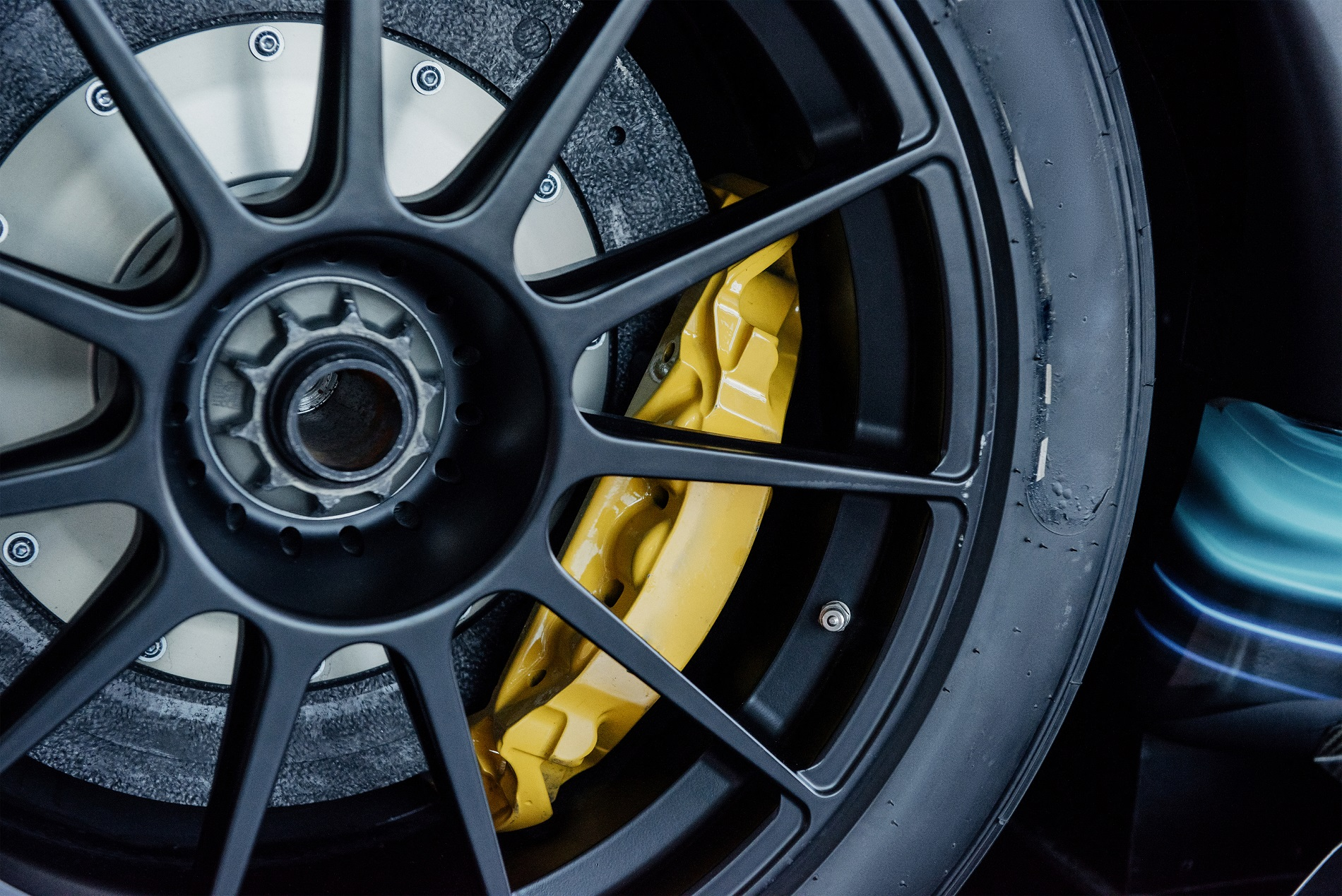 yellow powder coated disc brake on sports car